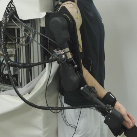 Adaptive Control of Exoskeleton Robots for Periodic Assistive Behaviours Based on EMG Feedback Minimisation