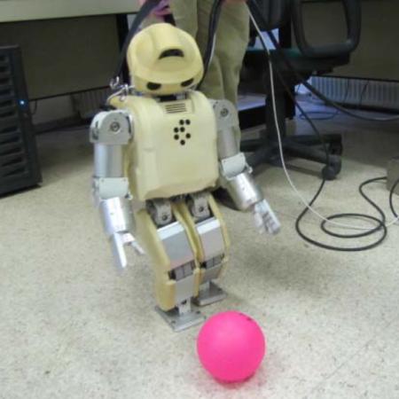 Programming and control of humanoid robot football playing tasks