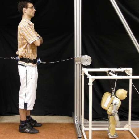 Humanoid robot posture-control learning in real-time based on human sensorimotor learning ability
